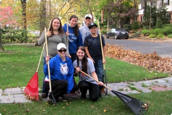Participants volunteer with raking