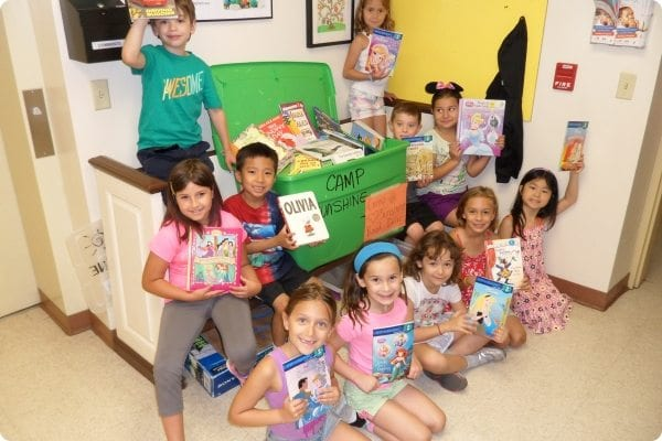 Campers showing off their books