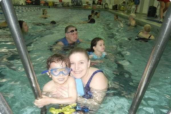 Mother and son swimming